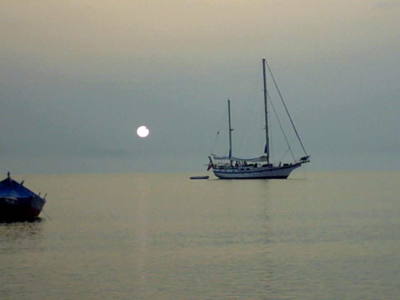 immagini tramonti, isola felice, viaggio vacanza corfu, barca pescatori